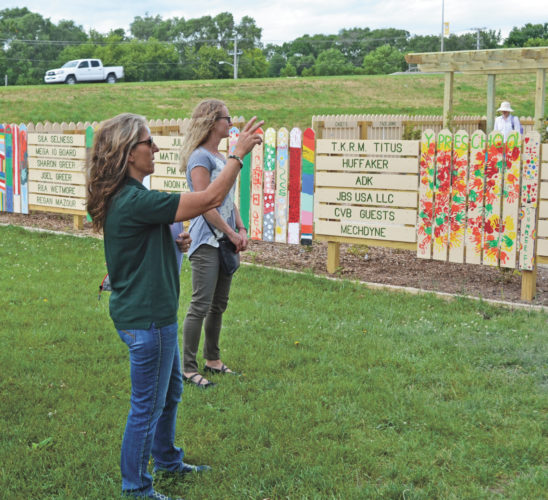 T-R PHOTO BY SARA JORDAN-HEINTZ During Wednesday afternoon's Parks and Rec. Advisory Committee meeting, Director Anne Selness (left) took committee members on a tour of Mega-10 Park, which has recently undergone a massive updating and renovating process. Committee member Kim Barnes (right) said she was amazed at the end result of the project.