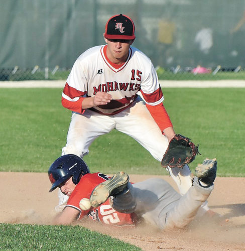 T-R PHOTO BY ANNE VANCE • Marshalltown's Wyatt Himes (20) is safe stealing second base in front of the throw intended for Mason City's Josh VandenBerg (15) during the fourth inning of Wednesday's CIML Iowa Conference nightcap at the MHS diamond.