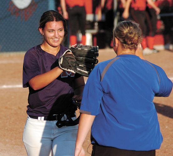 T-R PHOTO BY ROSS THEDE • Marshalltown junior pitcher McKaylee Dawson, left, is congratulated by assistant coach Taylor Wagner after the Bobcats defeated Mason City 3-2 in the opening game of Wednesday's CIML Iowa Conference doubleheader at the MHS diamond.