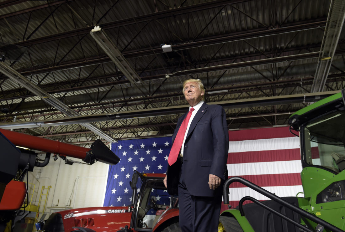 AP PHOTO President Donald Trump walks on stage to speak at Kirkwood Community College, which is recognized by the White House as a major center of agricultural innovation, during a visit to the campus in Cedar Rapids, Wednesday. This is Trump's first visit to Iowa since the election.