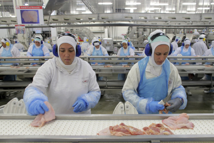AP PHOTO In this March 21, file photo, workers prep poultry at the meatpacking company JBS in Lapa, Brazil. In a major blow to Brazil, the United States on Thursday announced the immediate suspension of all imports of beef products from Latin America's largest nation because of safety concerns.