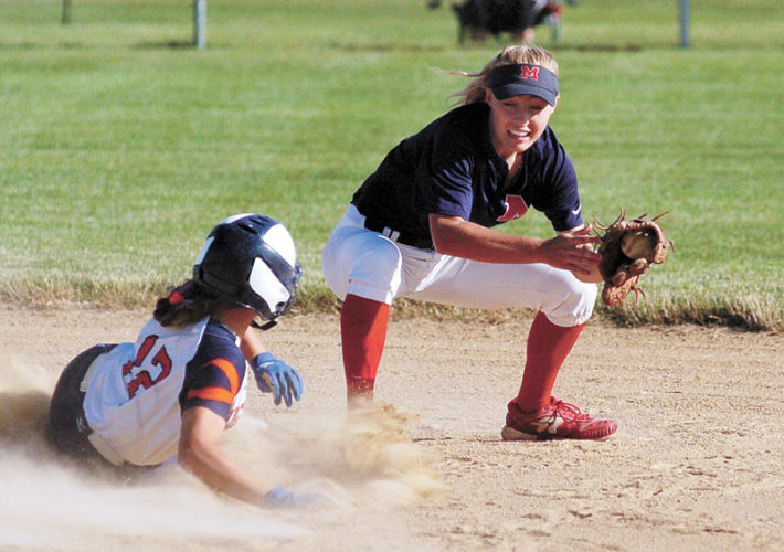 T-R PHOTO BY ROSS THEDE • Colfax-Mingo's Mackensie Brown (12) slides safely into second base with a double ahead of the tag by Marshalltown shortstop Regan Mazour during Friday's game at the Bobcat Softball Classic at Marshalltown Community College. The Class 1A No. 11-ranked Tigerhawks topped the Bobcats 6-0.