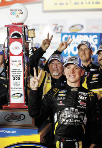 AP PHOTO • John Hunter Nemechek celebrates in Victory Lane after winning a NASCAR Camping World Truck Series auto race Friday night at Iowa Speedway in Newton. It was the second consecutive win for Nemechek.