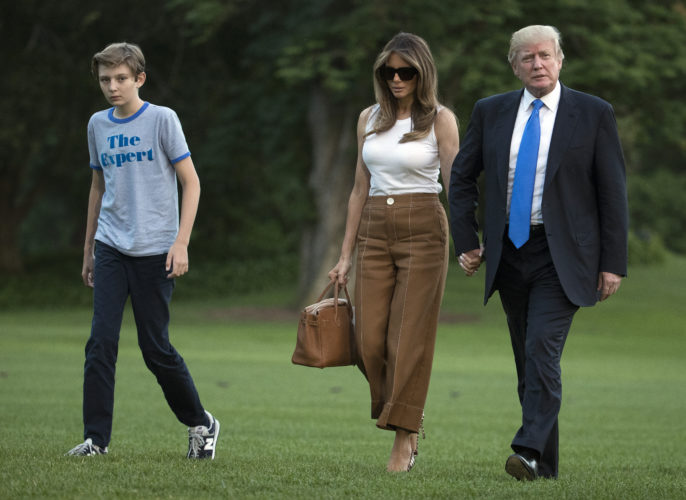 AP PHOTO President Donald Trump, first lady Melania Trump, and their son and Barron Trump walk from Marine One across the South Lawn to the White House in Washington, June 11, as they return from Bedminster, N.J.