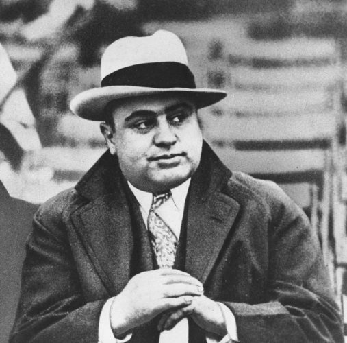 AP PHOTO In this Jan. 19, 1931 file photograph, Chicago mobster Al Capone is seen at a football game in Chicago.