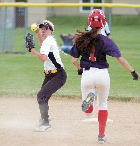 T-R PHOTO BY ROSS THEDE • BCLUW second baseman Samantha Ubben, left, readies her throw to first base for the double play after recording the force-out of Marshalltown's Erica Johnson (1) during the fourth inning of Saturday's game in the Bobcat Softball Classic.