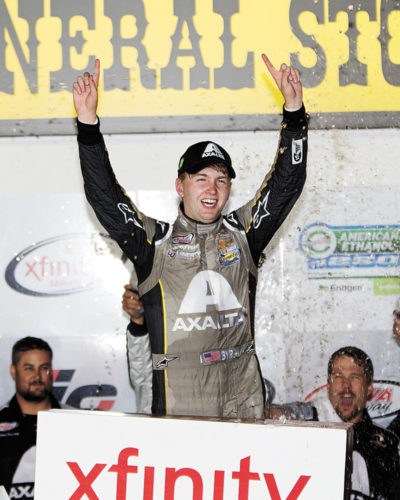 T-R PHOTO BY MARK GEORGE • William Byron celebrates in Victory Lane after winning the NASCAR Xfinity Series American Ethanol E15 250 auto race Saturday night at Iowa Speedway in Newton.