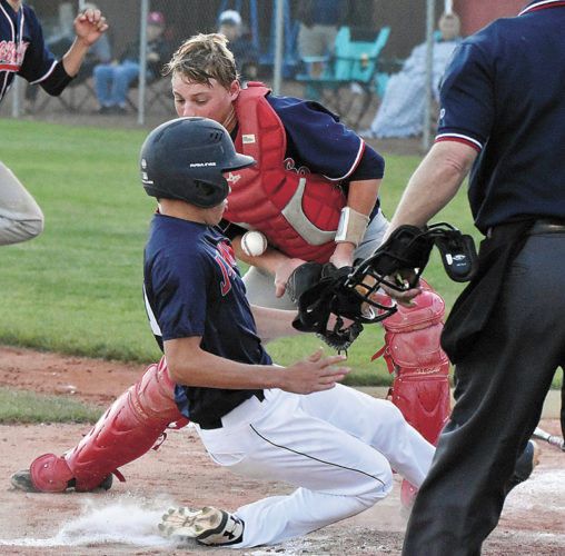 T-R PHOTO BY ANNE VANCE • Marshalltown catcher Will Van Buren tries to field the throw home as an Urbandale runners scores safely during Monday's CIML Iowa Conference doubleheader in Urbandale.