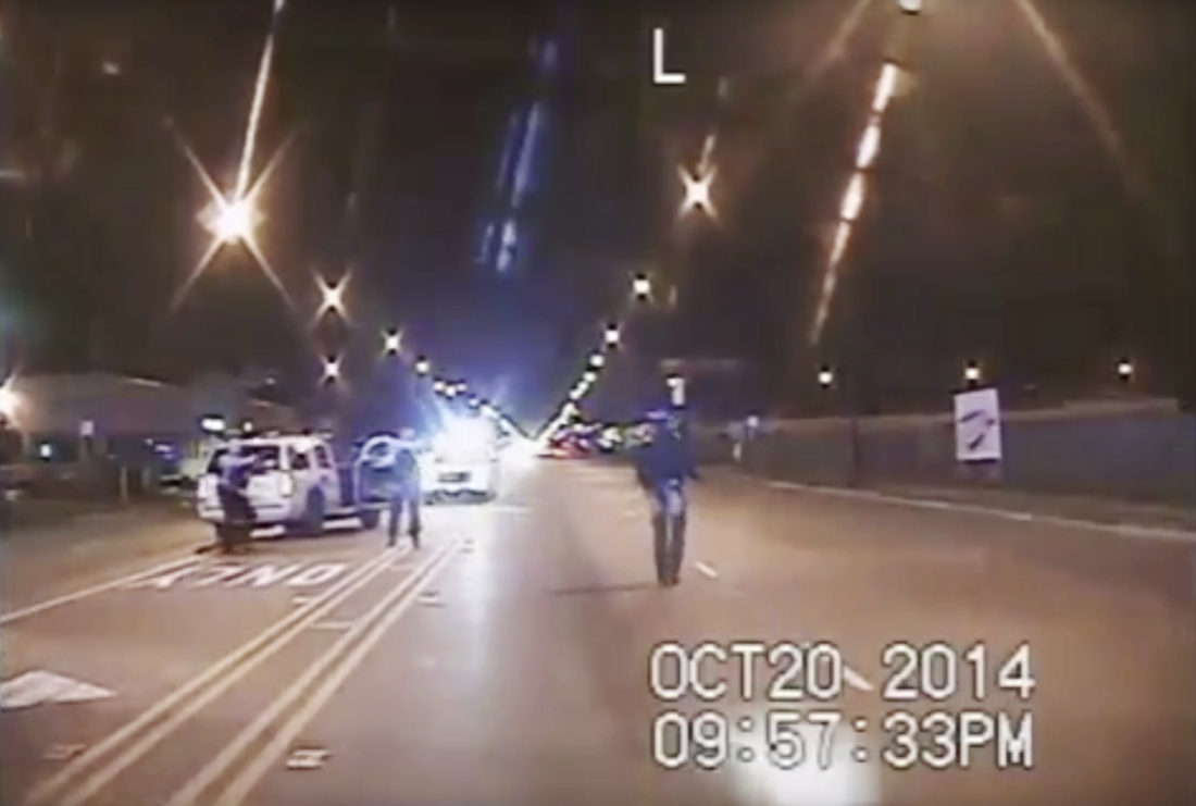 AP PHOTO In this Oct. 20, 2014 file image taken from dash-cam video provided by the Chicago Police Department, Laquan McDonald, right, walks down the street moments before being fatally shot by Chicago Police officer Jason Van Dyke in Chicago. Three Chicago police officers have been indicted on felony charges alleging they conspired to cover up the fatal shooting of black teen Laquan McDonald by a white officer. The three officers, Thomas Gaffney, David March and Joseph Walsh, were each charged Tuesday, with conspiracy, official misconduct and obstruction of justice.