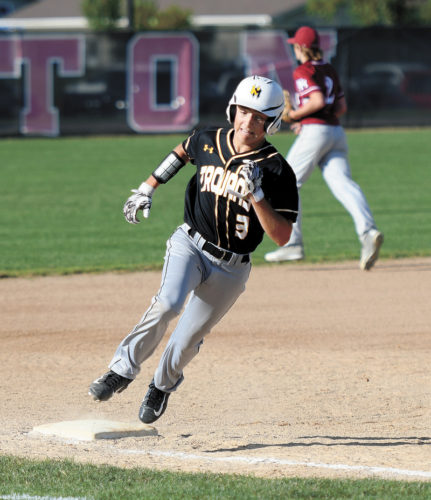 PHOTO BY TROY BANNING/DAILY FREEMAN-JOURNAL • West Marshall sophomore Jake Tollefson (3) rounds third base on his way to score a run during the first game of the Trojans' non-conference doubleheader at South Hamilton on Tuesday night. The Trojans swept the host Hawks, 15-0 and 13-3.