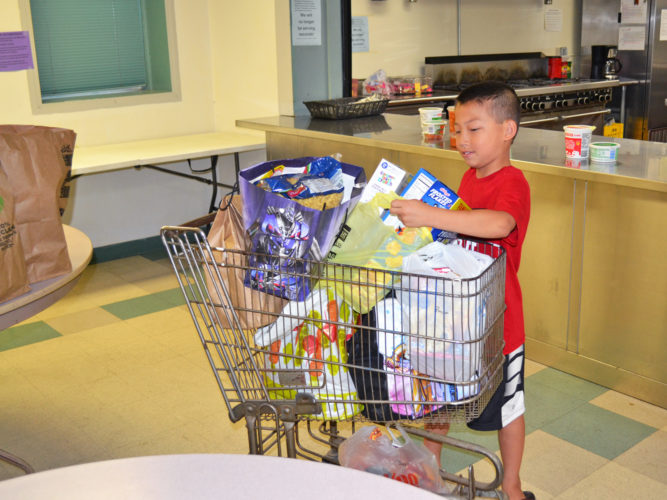 T-R PHOTO BY SARA JORDAN-HEINTZ Blake Russell, 9, of Marshalltown, asked guests to his recent birthday party to bring food and supplies in place of gifts. On Wednesday morning, he and his mom Shelly donated the goods to the House of Compassion.