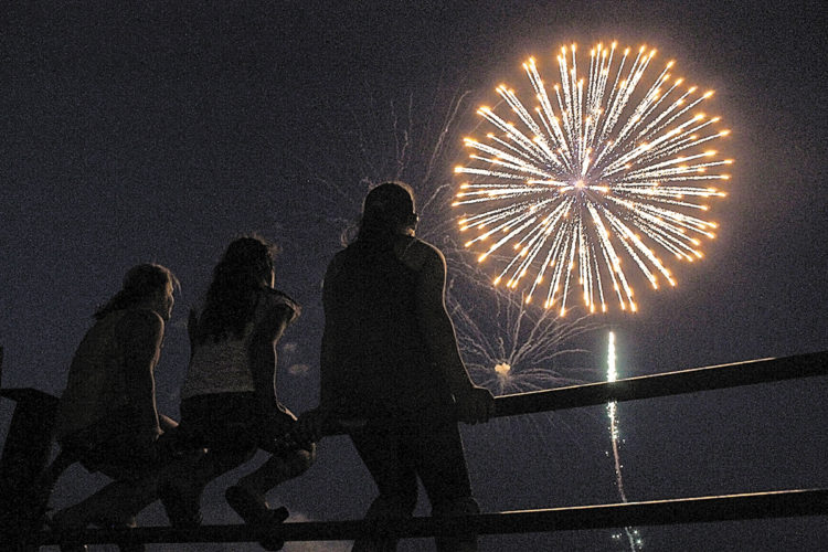 T-R FILE PHOTO From this 2012 file photo, three Marshalltown youth watch the town's annual fireworks display at the Marshall County Fairgrounds.
