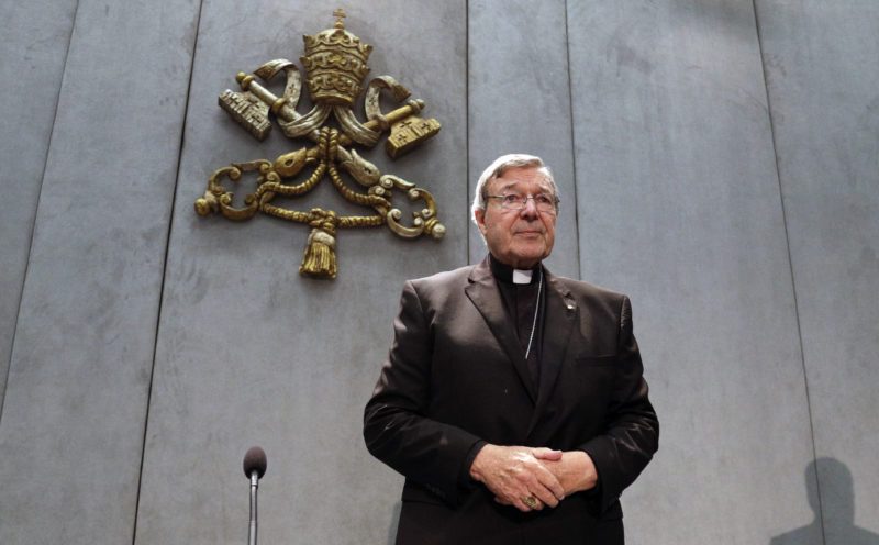 AP PHOTO Cardinal George Pell arrives to make a statement, at the Vatican, Thursday. The Catholic Archdiocese of Sydney says Vatican Cardinal George Pell will return to Australia to fight sexual assault charges as soon as possible.