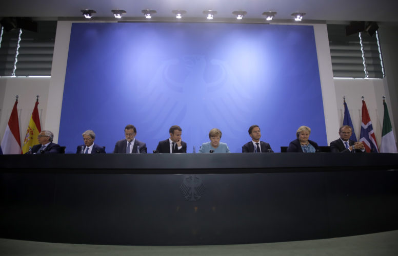 AP PHOTO European Commission President Jean-Claude Juncker, Italian Prime Minister Paolo Gentiloni, Spain's Prime Minister Mariano Rajoy, France's President Emmanuel Macron, German Chancellor Angela Merkel, Mark Rutte, Prime Minister of the Netherlands, Norway's Prime Minister Erna Solberg and European Council President Donald Tusk, from left, attend a press conference after a gathering of European leaders on the upcoming G-20 summit in the chancellery in Berlin, Germany, Thursday.