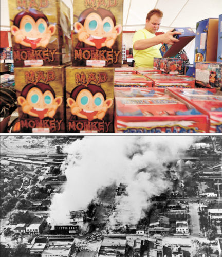 AP PHOTOS ABOVE: In this June 16 photo, Julian Gibson, of Dallas Center, looks at fireworks for sale in a tent owned by the Iowa Fireworks Company, in Adel. BELOW: This June 27, 1931, aerial photo provided by Clay County Heritage shows a fire in Spencer, after a dropped sparkler ignited an inferno that roared through much of the small city. The fire led to a statewide fireworks ban that endured for generations.