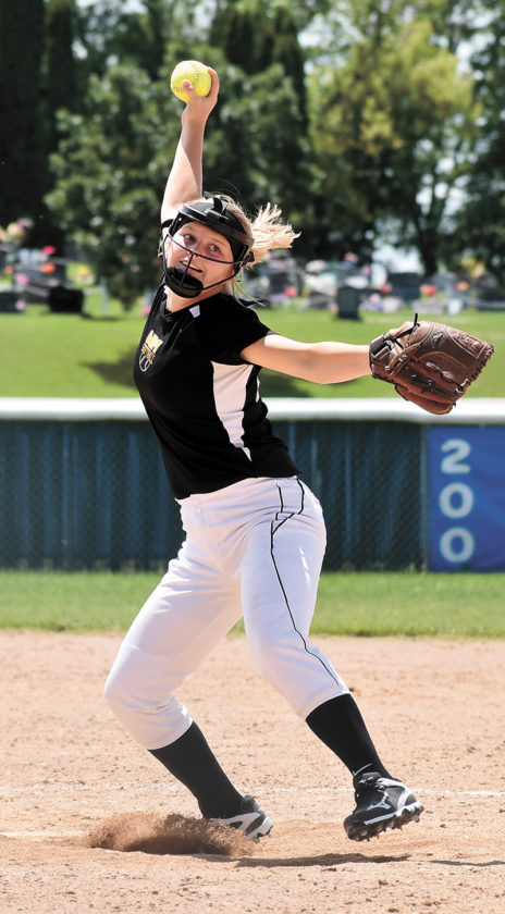 T-R PHOTO BY THORN COMPTON • West Marshall eighth-grader Loran Nicholson winds up to deliver a pitch during the Trojans' loss to Pella Christian on Saturday in the Don Bosco Tournament.