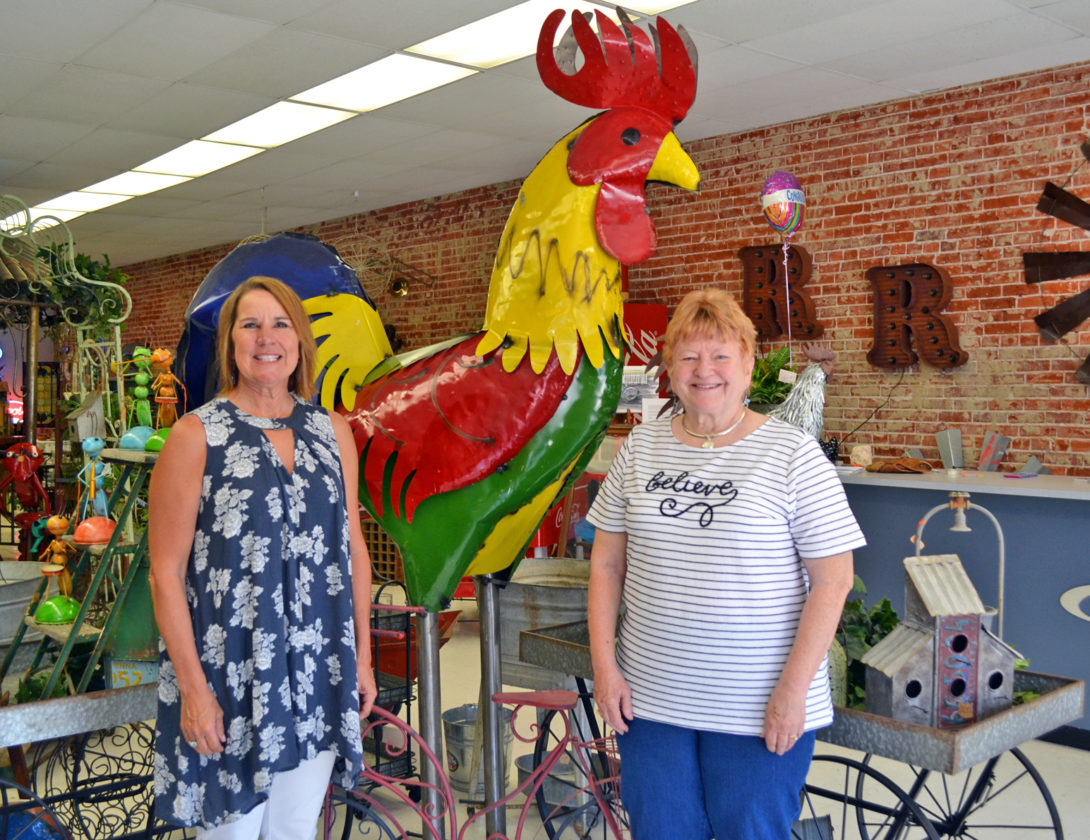 T-R PHOTO BY SARA JORDAN-HEINTZ The Retro Rooster, located at 548 2nd St. in Traer, is now open for business. Run by Bev Espenscheid, left, and Linda Caldwell, right, it offers vintage jewelry, rustic decor, furniture, antiques and knick-knacks. Playing up the store's theme, an eight-feet-tall painted metal rooster is one of the first things that catches one's eye upon entering the store.