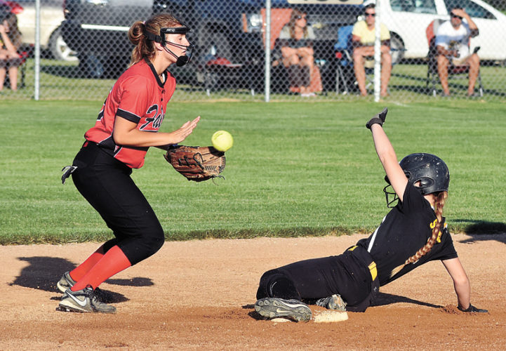 T-R PHOTO BY THORN COMPTON • BCLUW pinch-runner Parker Scurr slides into second base off a steal attempt in the top of the first inning while Aplington-Parkersburg second baseman Maddie Waller catches the throw-out attempt in the Comets' 16-0 win over the Falcons on Wednesday evening.