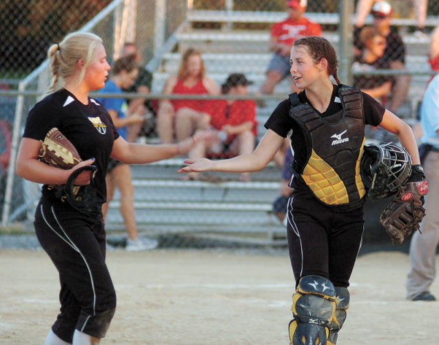 T-R PHOTO BY ROSS THEDE • West Marshall senior catcher Georgia Porter, right, congratulates pitcher Kallie Malloy after getting out of a bases-loaded jam in the bottom of the sixth inning during Wednesday's Class 3A Region 8 quarterfinal softball game in State Center. Malloy struck out 13 as the 10th-ranked Trojans defeated Creston 9-0.