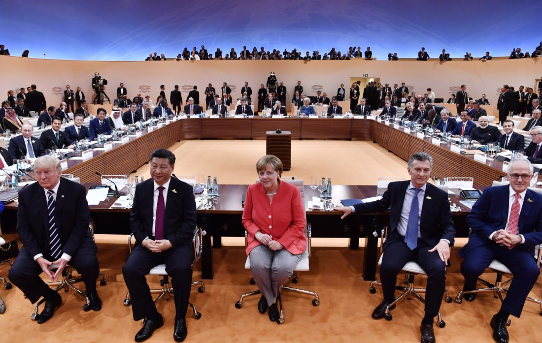 AP PHOTO From left:  US President Donald Trump, China's President Xi Jinping, German Chancellor Angela Merkel, Argentina's President Mauricio Macri and Australia's Prime Minister Malcolm Turnbull turn around for photographers at the start of the G20 meeting in Hamburg, northern Germany, on Friday.