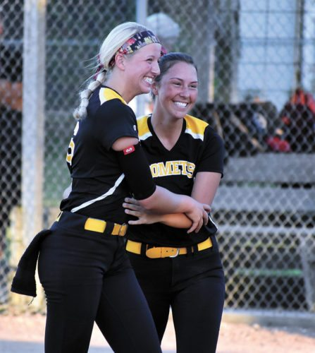 T-R PHOTO BY THORN COMPTON • BCLUW senior Samantha Ubben, left, celebrates with senior Macy Kock after the Comets won their Class 2A Region 3 semifinal game against South Hamilton on Friday 4-1. With the win, BCLUW moves on to face Waterloo Columbus on Monday with a trip to the state tournament on the line.