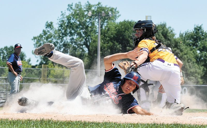 T-R PHOTO BY THORN COMPTON • Bobcats junior Brian Trowbridge slides into home while scoring a run during the fourth inning of Marshalltown's 9-6 loss to Class 4A No. 1 Johnston on Friday.