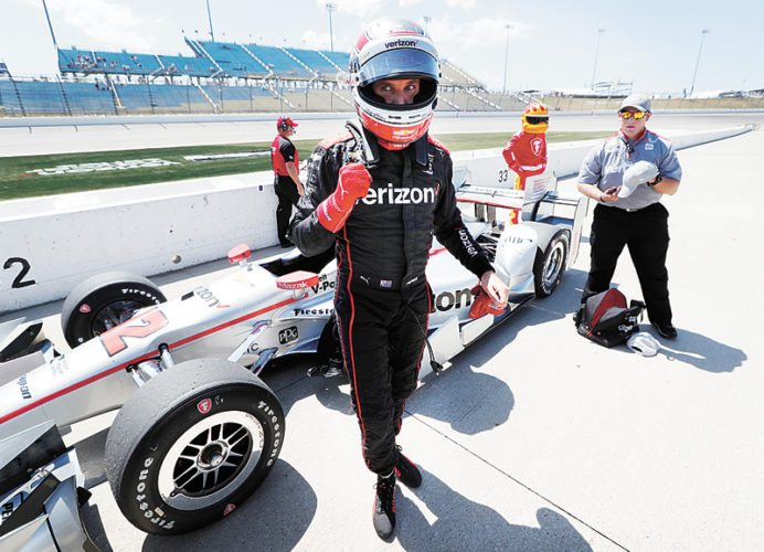 AP PHOTO • Will Power pumps his fist after winning the pole position for the IndyCar Series auto race Saturday at Iowa Speedway in Newton.