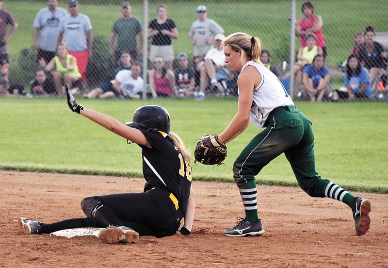 T-R PHOTO BY THORN COMPTON • Comets senior Jordyn Beeghly slides into second after hitting a tenth-inning double in BCLUW's 1-0 loss on Monday to Waterloo Columbus. Beeghly led the team with two hits in the game.