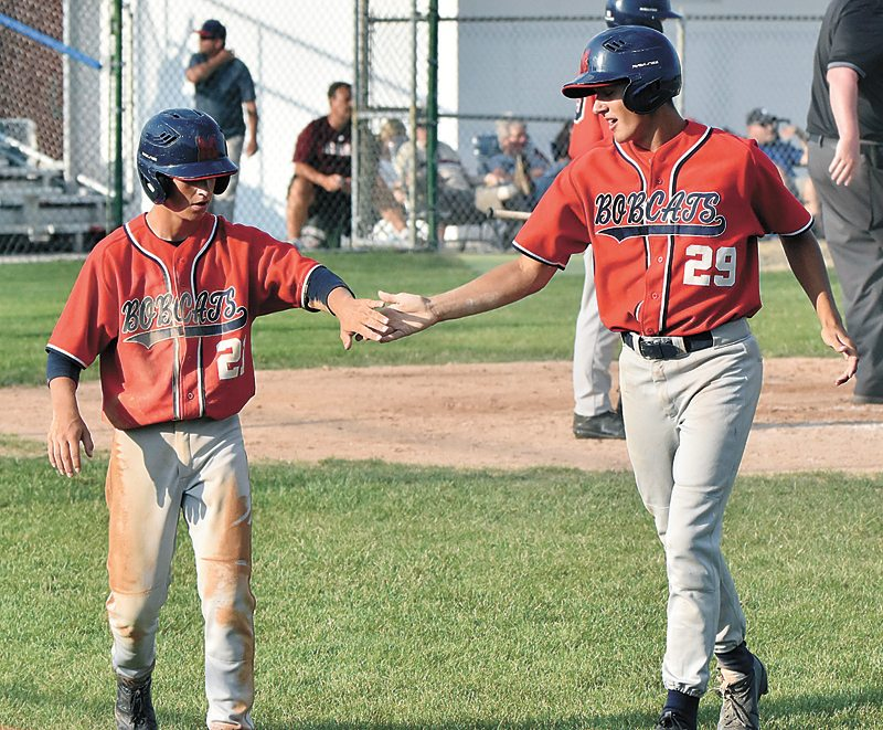 T-R PHOTO BY ANNE VANCE • Marshalltown's Nate Vance and Brian Trowbridge share a celebration after scoring runs during game one of Monday's home doubleheader against Des Moines Lincoln.