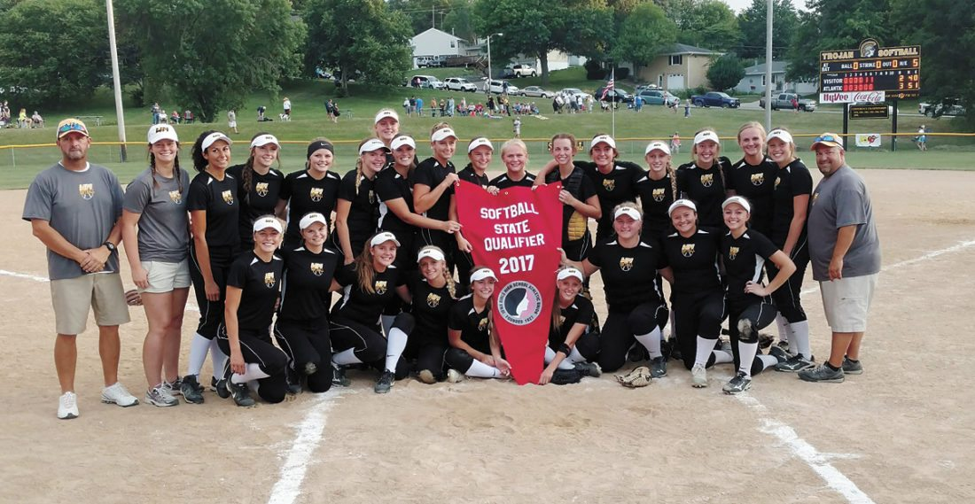 PHOTO COURTESY MID-IOWA ENTERPRISE • The West Marshall softball team poses with its Class 3A state qualifier banner after beating Atlantic 3-2 in Monday's Region 8 championship game in Atlantic. The win clinched the Trojans' first state trip since back-to-back appearances in 2002 and 2003.