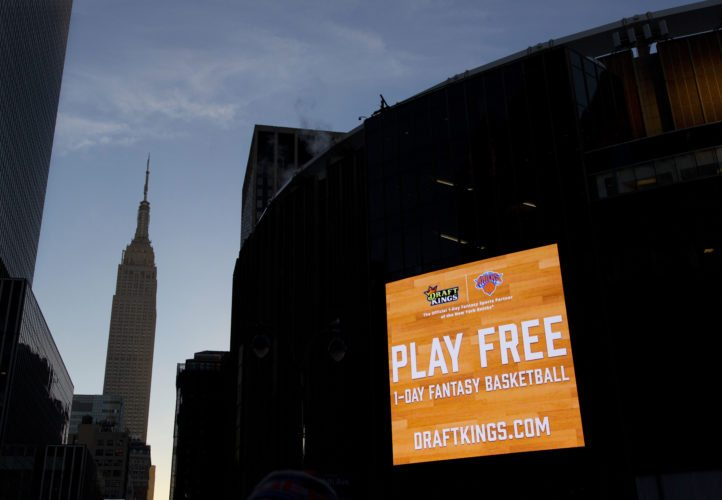 AP PHOTO In this Jan. 6, 2016 file photo, an electronic advertisement for DraftKings hangs on the side of Madison Square Garden in New York. On Thursday, DraftKings announced it pulled out of a proposed merger with FanDuel, scrapping potential partnership between fantasy sports companies.