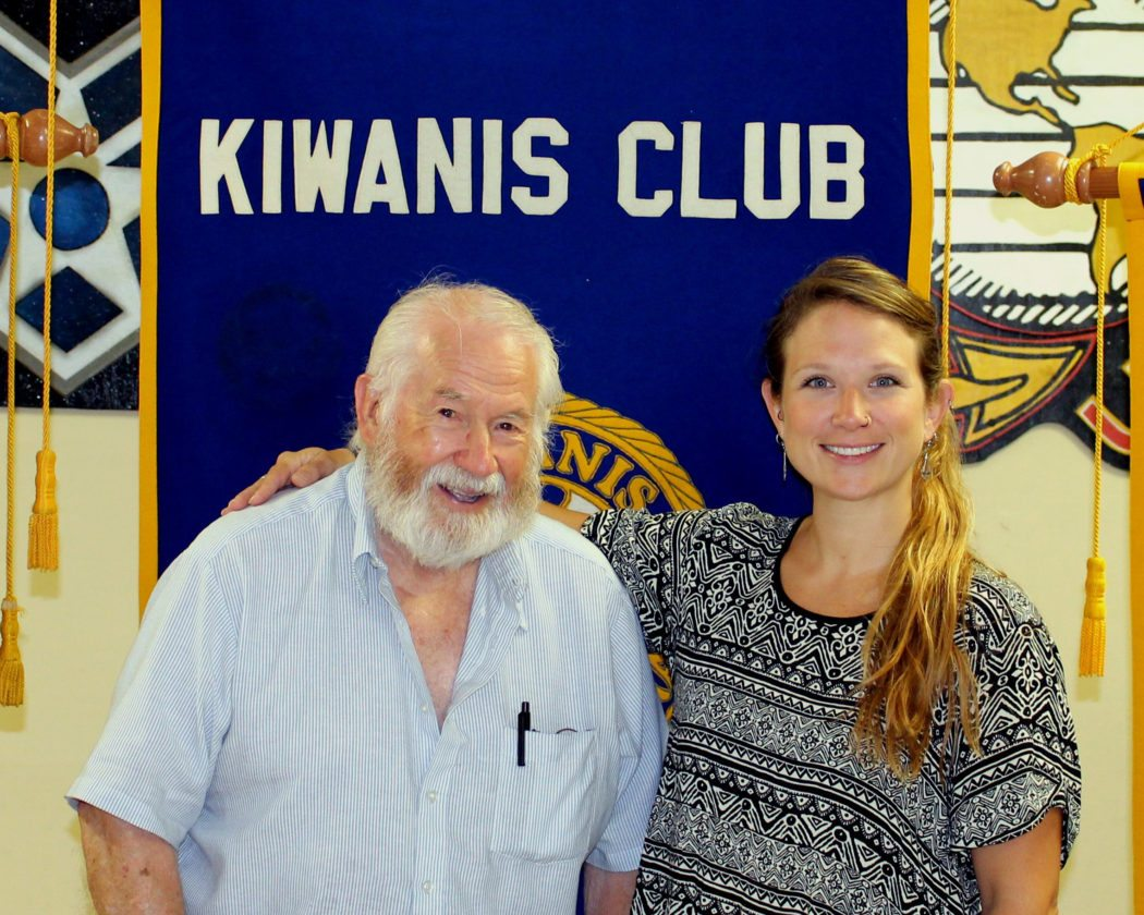 """CONTRIBUTED PHOTO Kiwanis """"Noon"""" member Harold Cline welcomes Central Iowa Art Association Director Keeley Weeks who presented a program on the history of the Art Association in Marshalltown."""
