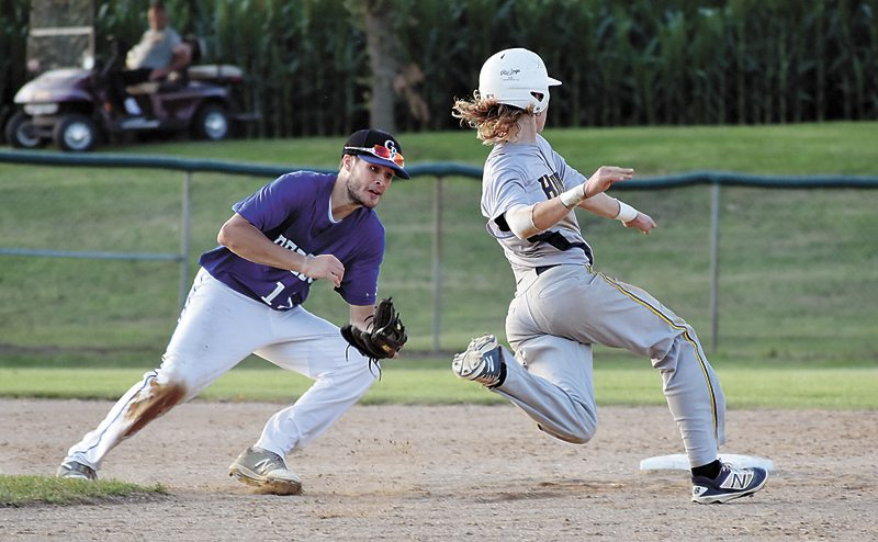 T-R PHOTO BY THORN COMPTON • Rebels senior Joe Smoldt attempts to tag out Hudson junior Alex Hageman while he steals second base during the sixth inning of Gladbrook-Reinbeck's loss to the Pirates in their district finals match on Saturday in Traer.