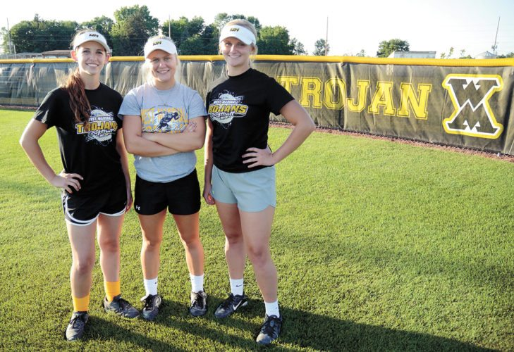 T-R PHOTO BY ROSS THEDE • West Marshall seniors (from left) Georgia Porter, Kallie Malloy and Kylie Cripps have helped resurrect a  program that hadn't been to state since 2003.