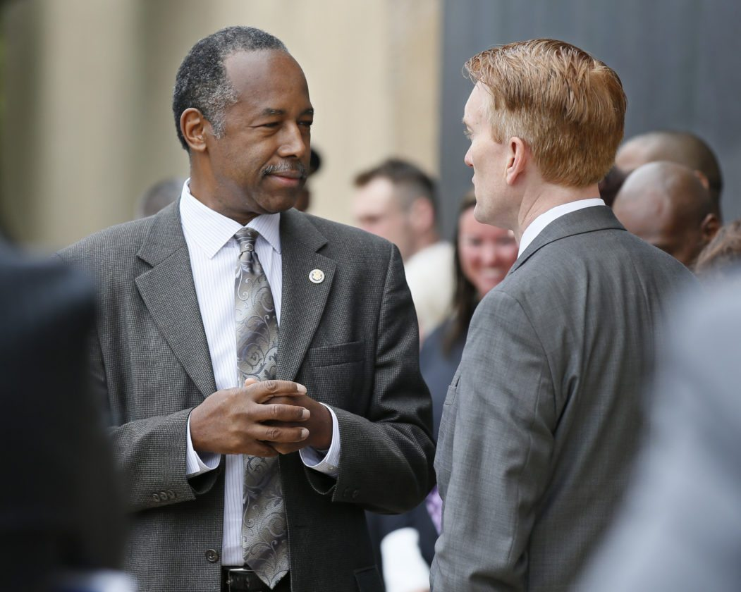AP PHOTO In this photo taken April 19, Housing and Urban Development Secretary Ben Carson, left, talks with Sen. James Lankford, R-Okla. in Oklahoma City, Oklahoma.
