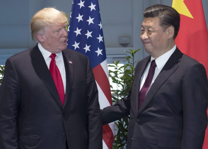 AP PHOTO In this July 8, file photo, U.S. President Donald Trump, left, and Chinese President Xi Jinping arrive for a meeting on the sidelines of the G-20 Summit in Hamburg, Germany. After a cordial meeting between Trump and Xi in April 2017, tensions are simmering again between the world's two biggest economies.