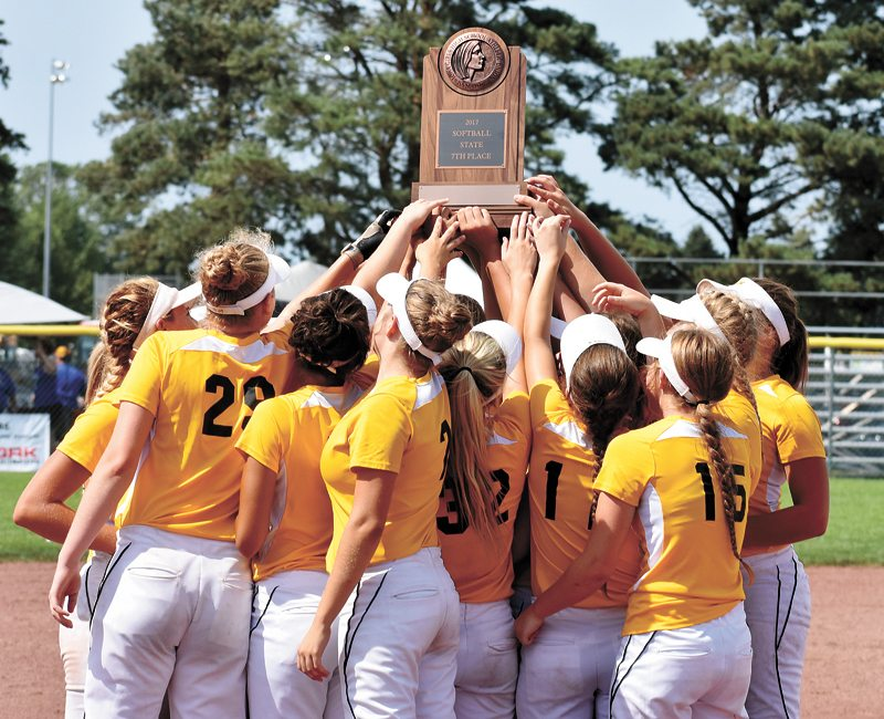 T-R PHOTO BY THORN COMPTON • West Marshall softball players celebrate with their seventh-place trophy after defeating Boyden-Hull/Rock Valley in their final game of the 2017 Iowa Girls' High School State Softball Championships on Wednesday in Fort Dodge.