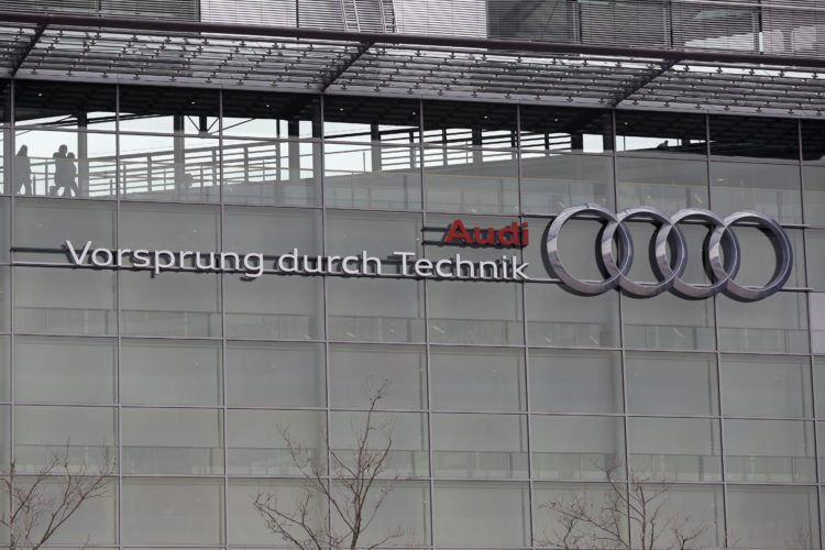AP PHOTO In this March 15, file photo, the four ring logo of German car producer Audi is photographed at the headquarters after the annual press conference in Ingolstadt, Germany. German automaker Audi says it will fit up to 850,000 diesel cars with new software to improve their emissions performance, following a similar move by rival Daimler as the auto industry tries to get ahead of public controversy over the technology. Audi, the luxury brand of the Volkswagen Group, announced the voluntary retrofitting program on Friday.