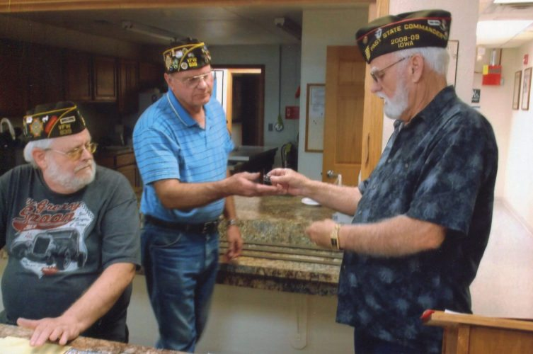 CONTRIBUTED PHOTO VFW Post 839 Commander Larry Larson, right, presents a Past Commander's Pin to Dallas Clark, with Quartermaster Roger Dirks looking on at left.