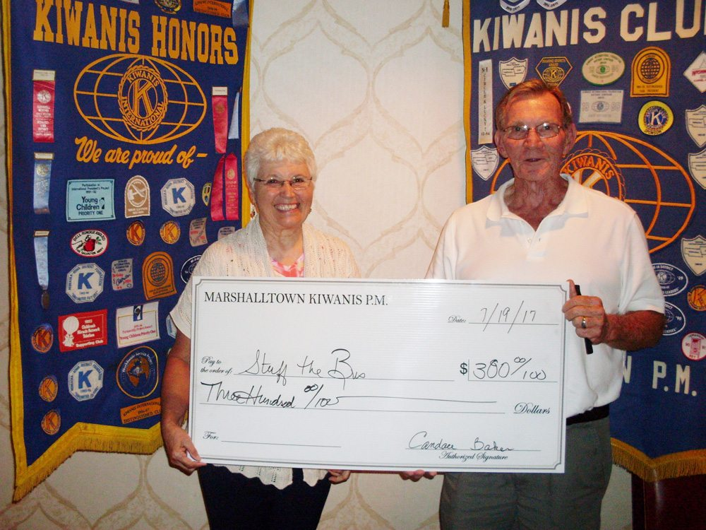 CONTRIBUTED PHOTO Kiwanis P.M. President Kenny Lamb welcomes Rita Smith as the guest speaker. Smith is one of the volunteers working on the Stuff the Bus campaign for the House of Compassion.