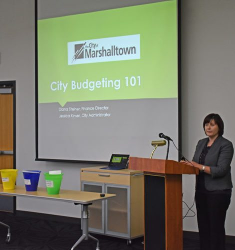 """T-R FILE PHOTO From this June 22 photo, Marshalltown City Administrator Jessica Kinser addresses audience during the first """"City Budgeting 101"""" presentation at the public library. The final program is 6 p.m. Thursday at the library."""