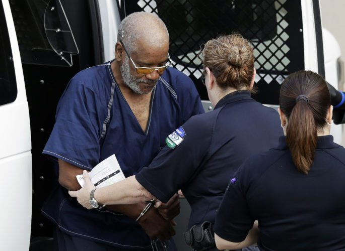 AP PHOTO James Mathew Bradley Jr., left, arrives at the federal courthouse for a hearing, Monday, in San Antonio. Bradley was arrested in connection with the deaths of multiple people packed into a broiling tractor-trailer.
