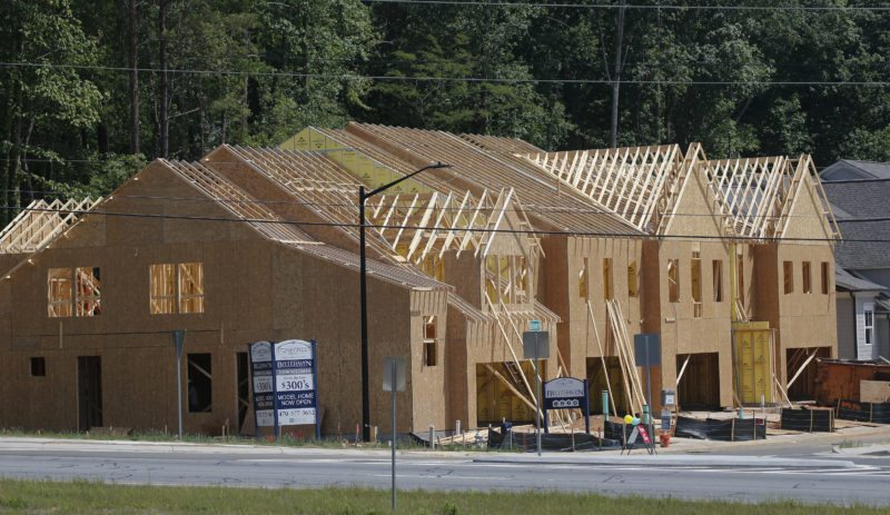 AP PHOTO This May 16, photo shows new town homes under construction in Woodstock, Ga. The Standard & Poor's/Case-Shiller 20-city home price index for May is released, Tuesday.