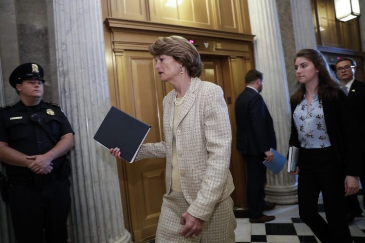 AP PHOTO Sen. Lisa Murkowski, R-Alaska, arrives for a vote as the Republican-run Senate rejected a GOP proposal to scuttle President Barack Obama's health care law and give Congress two years to devise a replacement, Wednesday, at the Capitol in Washington.