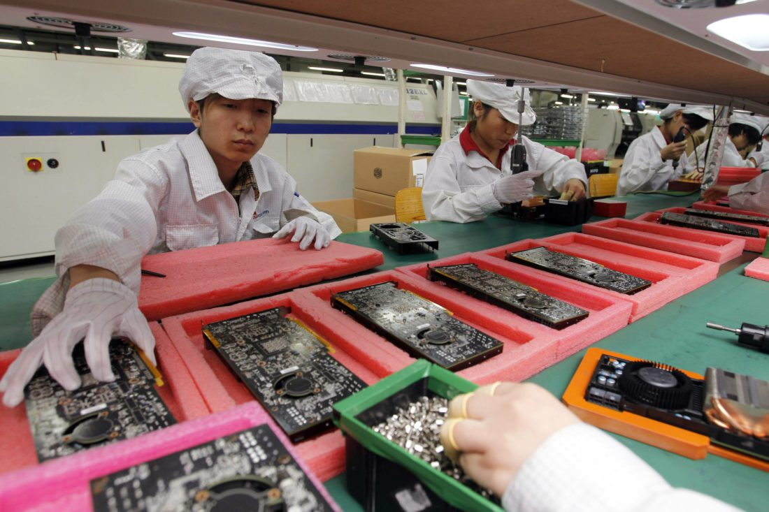 AP PHOTO In this May 26, 2010 file photo, staff members work on the production line at the Foxconn complex in the southern Chinese city of Shenzhen, Southern city in China.
