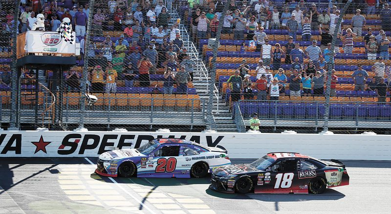 AP PHOTO • Ryan Preece (20) edges Kyle Benjamin (18) at the finish line as he wins the NASCAR Xfinity Series US Cellular 250 auto race Saturday at Iowa Speedway in Newton.