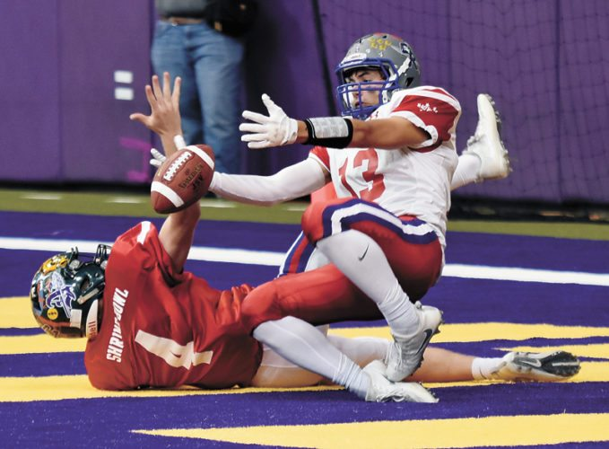 T-R PHOTO BY THORN COMPTON • Gladbrook-Reinbeck graduate Erik Knaack keeps his concentration and nearly hauls in a catch in the end zone while his North team rolls to a 30-13 victory over the South in the 46th annual Iowa Shrine Bowl on Saturday at the UNI-Dome in Cedar Falls.