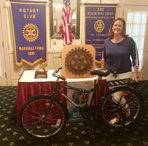 CONTRIBUTED PHOTO Heidi Drager displays a World Bicycle Relief bicycle to a Rotarian crowd at their weekly luncheon. It will be a district project for the Marshalltown Rotary club to provide these utilitarian units in developing countries.