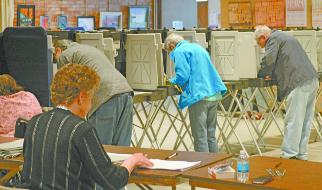 T-R FILE PHOTO  Voters at Marshalltown's Fisher Community Center — Ward 3 — exercise their right to vote. Voters in the ward unofficially supported the local option sales tax re-allocation 208 yes to 181.
