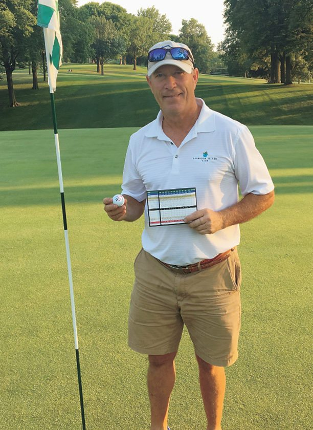 PHOTO PROVIDED • Bob Brooks poses with his scorecard and ball after shooting an Elmwood Country Club course-record 59 on Tuesday evening.